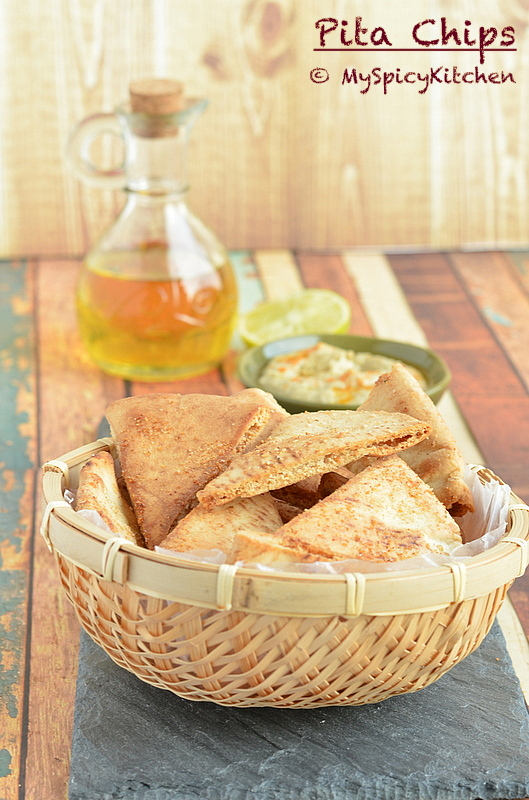 crispy, baked pita chips in a basket