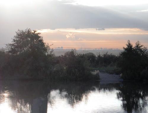 Langdon Lake in dusk, with London Skyline