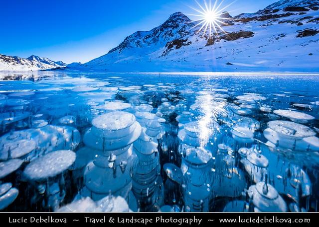 Switzerland - Alps - Deep frozen Lago Bianco - White Lake with surreal bubbles