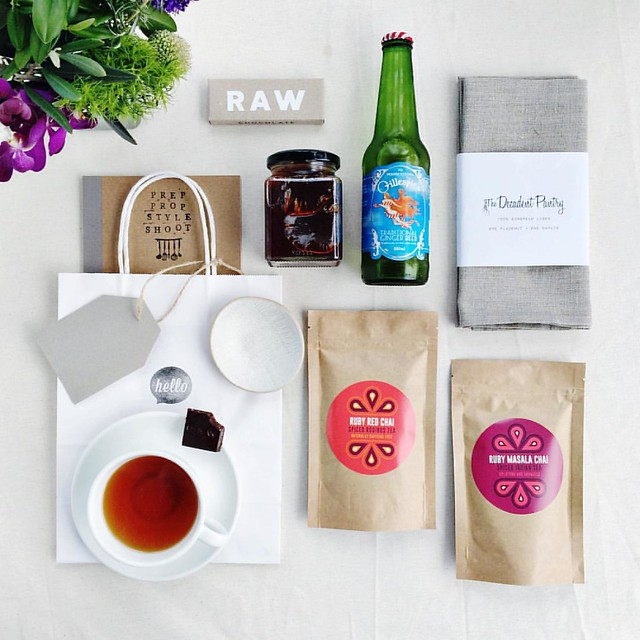 A huge thanks to our #preppropstyleshoot goodie bag partners @rubychaitea, @r_a_w_chocolate @decadentpantry & @gillespiesgingerbeer! . . . Tea, chocolate, designated driver bubbles and props - some of my favourite things ?