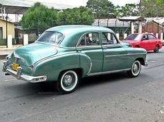 automobile(1.0), automotive exterior(1.0), vehicle(1.0), mid-size car(1.0), plymouth cranbrook(1.0), compact car(1.0), antique car(1.0), sedan(1.0), classic car(1.0), vintage car(1.0), land vehicle(1.0), luxury vehicle(1.0),
