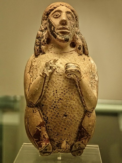Terracotta scent bottle in the form of a squatting man, perhaps a comic actor  Corinthian from Camirus Rhodes 600-575 BCE