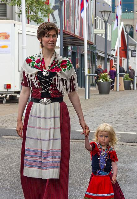 Young girl holding hands with her mother at Ólavsøka / Ólafsvaka in Tórshavn, Faroe Islands