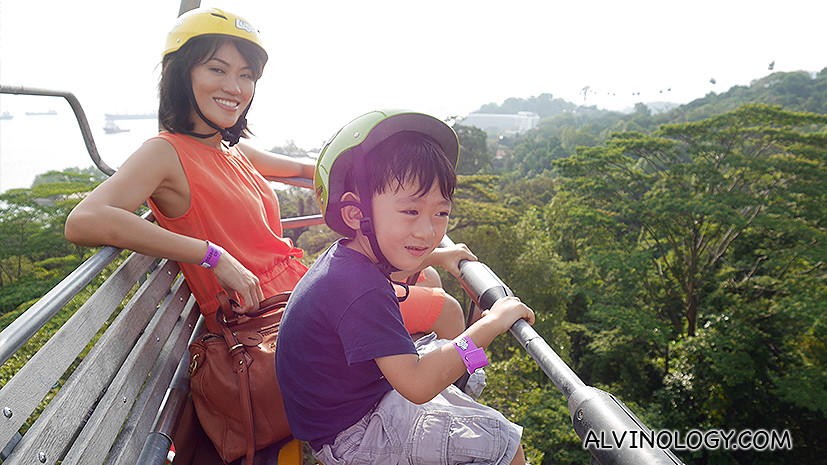 My wife and son enjoying the gondola ride up the slope for our luge rides down