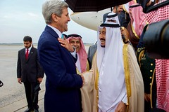 U.S. Secretary of State John Kerry speaks with King Salman bin Abdulaziz of Saudi Arabia after he deplaned from his Boeing 747 following his arrival at Andrews Air Force Base in Camp Springs, Maryland, on September 3, 2015, to visit President Barack Obama. [State Department photo/ Public Domain]