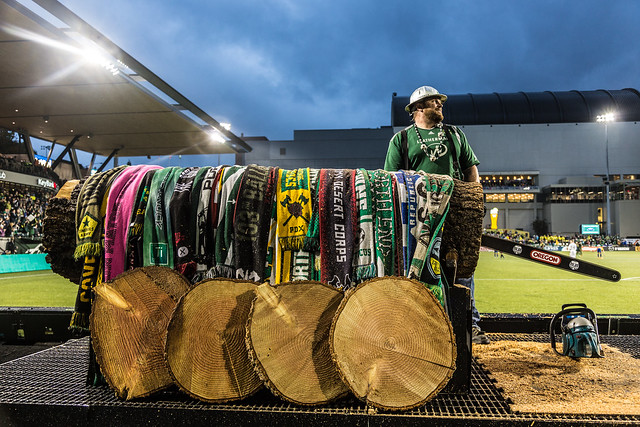 Joey playing Tetris on the Chainsaw with the celebrating Timbers Army.