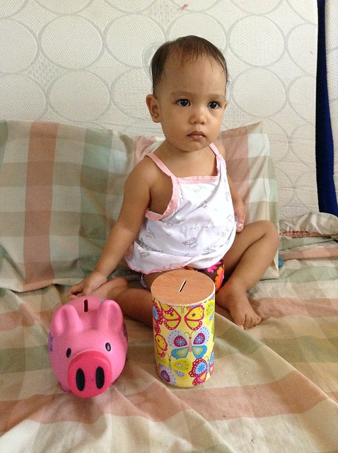 Nati and her piggy bank and new coin bank.