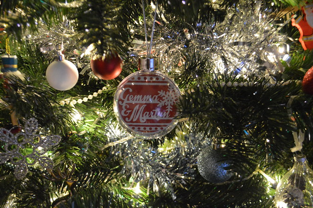 A photo of a christmas bauble on tree
