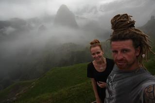 Selfie over the clouded Machu Picchu