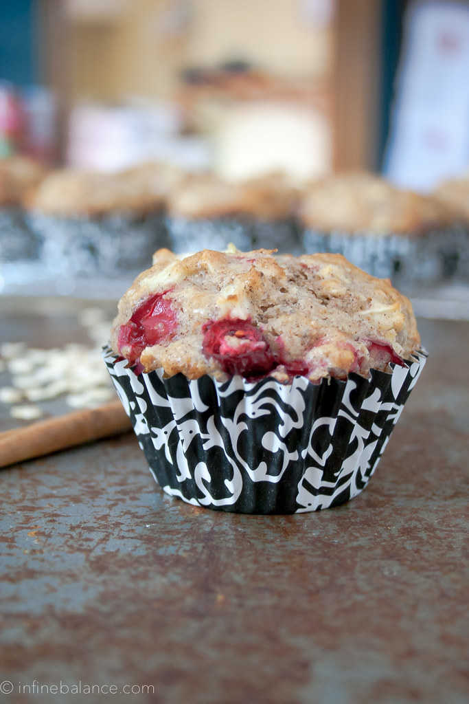 side view of a cranberry and apple muffin in black and white wrapping