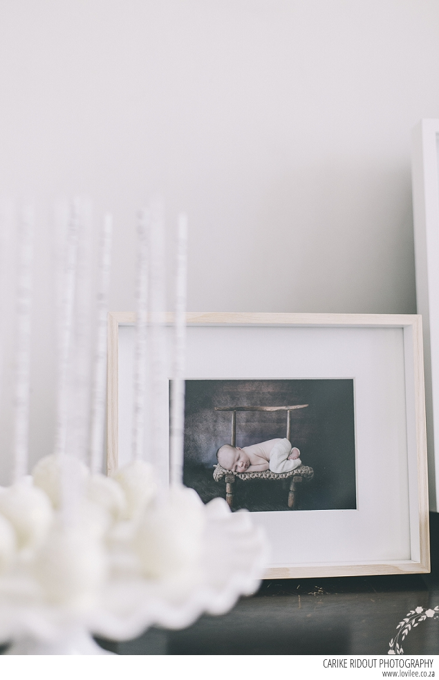 Framed newborn photo in a white frame