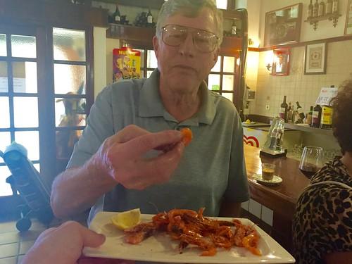 Paul eating baby shrimp