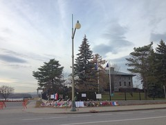 Flowers and other items in front of the Embassy of France in Ottawa