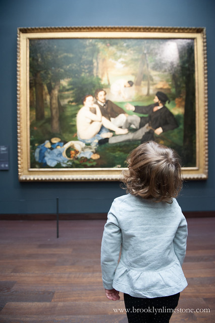 Aggie looking at a painting at the fine art museum, the Musee d'Orsay