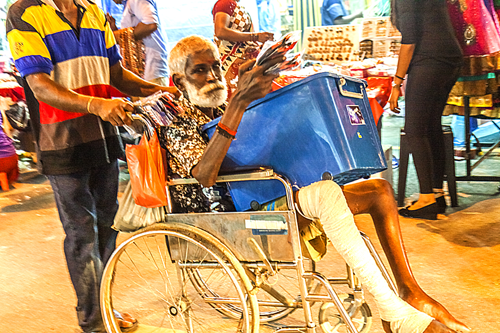 Man in wheelchair selling socks--Johor Bahru