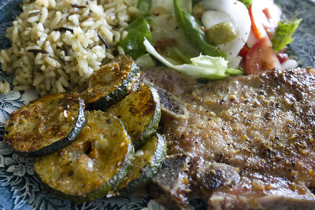 Pork chops, zucchini, wild rice and salad