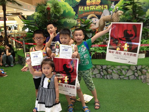 Children hold Animals Asia's No Voice No Choice posters