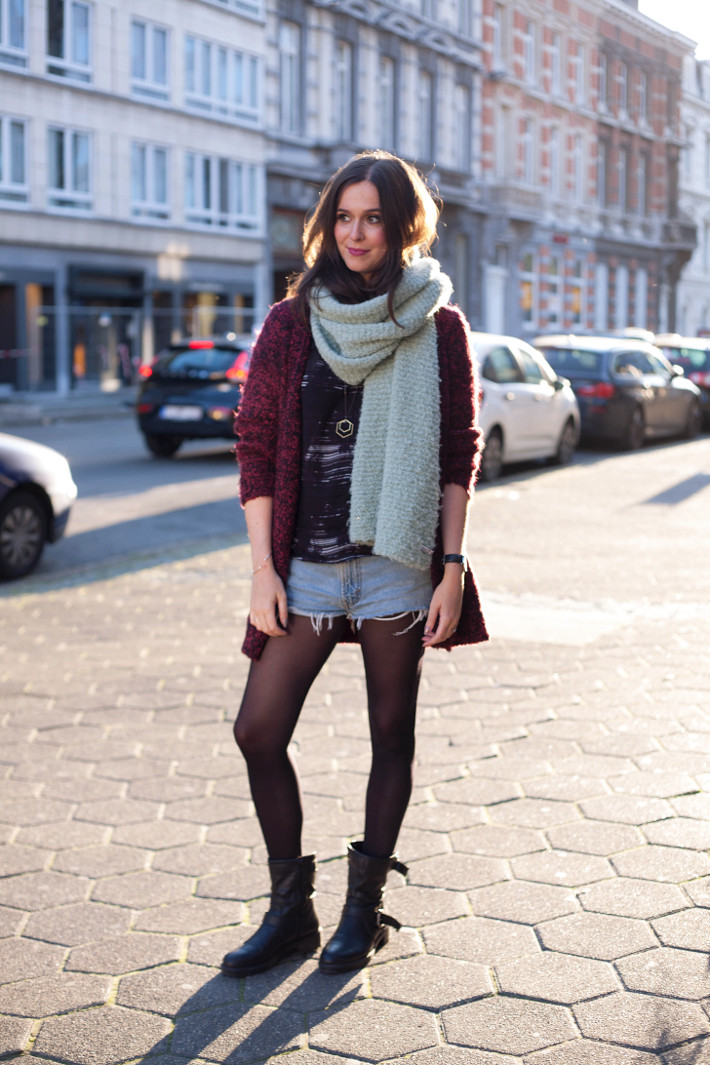 Outfit: longline cardigan, denim cutoffs, motor boots and oversized scarf