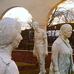 Sculptures by George Segal at sunset.