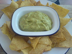 vegetable(0.0), baked goods(0.0), produce(0.0), condiment(1.0), vegetarian food(1.0), dip(1.0), tortilla chip(1.0), food(1.0), dish(1.0), guacamole(1.0), cuisine(1.0),