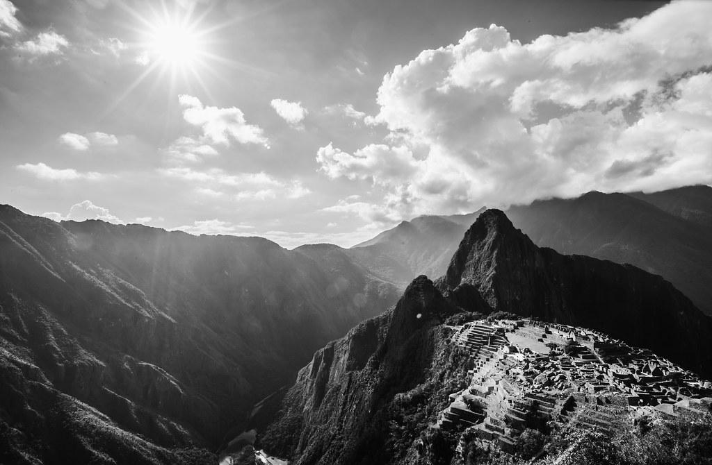 Sun shines high over Machu Pichu