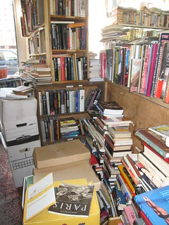 A shot of MacLeod's Bookstore. Books are everywhere. They're stacked on the floor, on shelves. Everywhere.