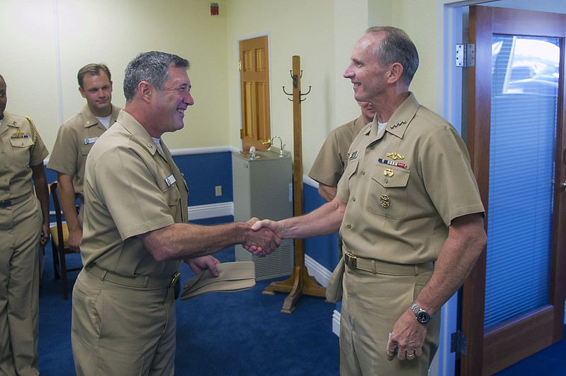 Capt. Frank Olmo (left), greets Chief of Naval Operations, Adm. Johnathan Greenert