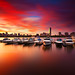 Fiery Sunrise over Boston Skyline and Charles River with Hancock and Prudential Towers, Charles River Yacht Club Cambridge Massachusetts USA by Greg DuBois Photography