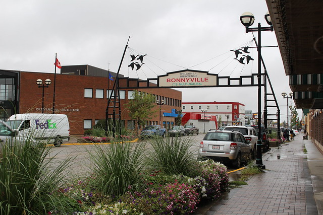 Downtown Bonnyville sign overtop the road on a rainy day
