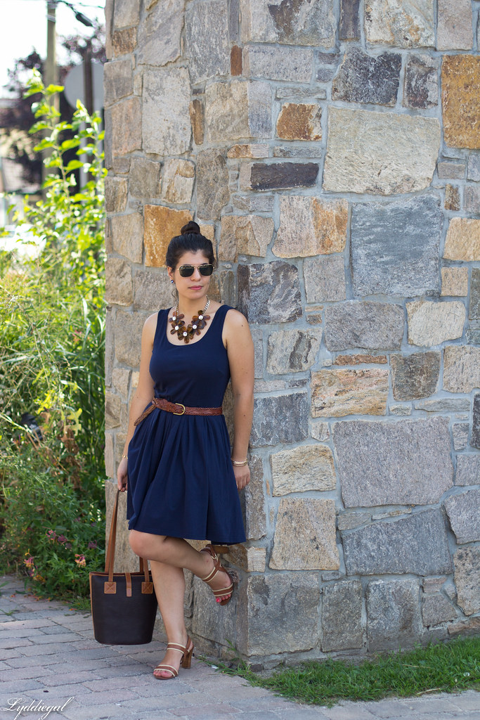 navy dress, dooney and burke tote, tortoise flower necklace.jpg