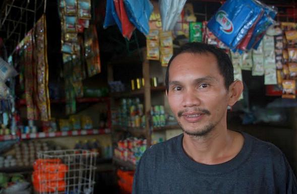 Batan public market vendor Ariel Dormido