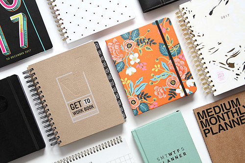 group of spiral notebook planners