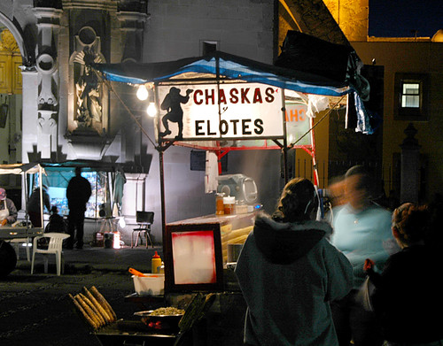 Elotes (Corn on the cob with cream and chiles) stand at night in Aguascalientes, Mexico