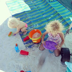 Nora and Claire love playing in the sand. 😍😍😍 Being their mamma and playing at the beach with them might have cured me of my sand hatred. #exploringthesunshinestate