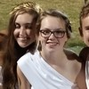 My daughter. In a toga. At a football game. #karma
