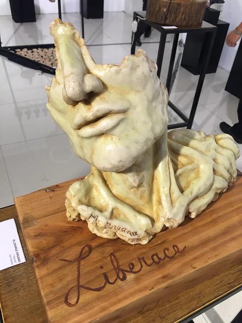 L:iberace,  face sculpture
