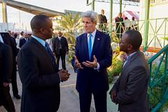 U.S. Secretary of State John Kerry speaks with Haitian social media leaders Carel Pedre and John Fritz Moreau in Port-au-Prince, Haiti, on October 6, 2015. [State Department photo/ Public Domain]