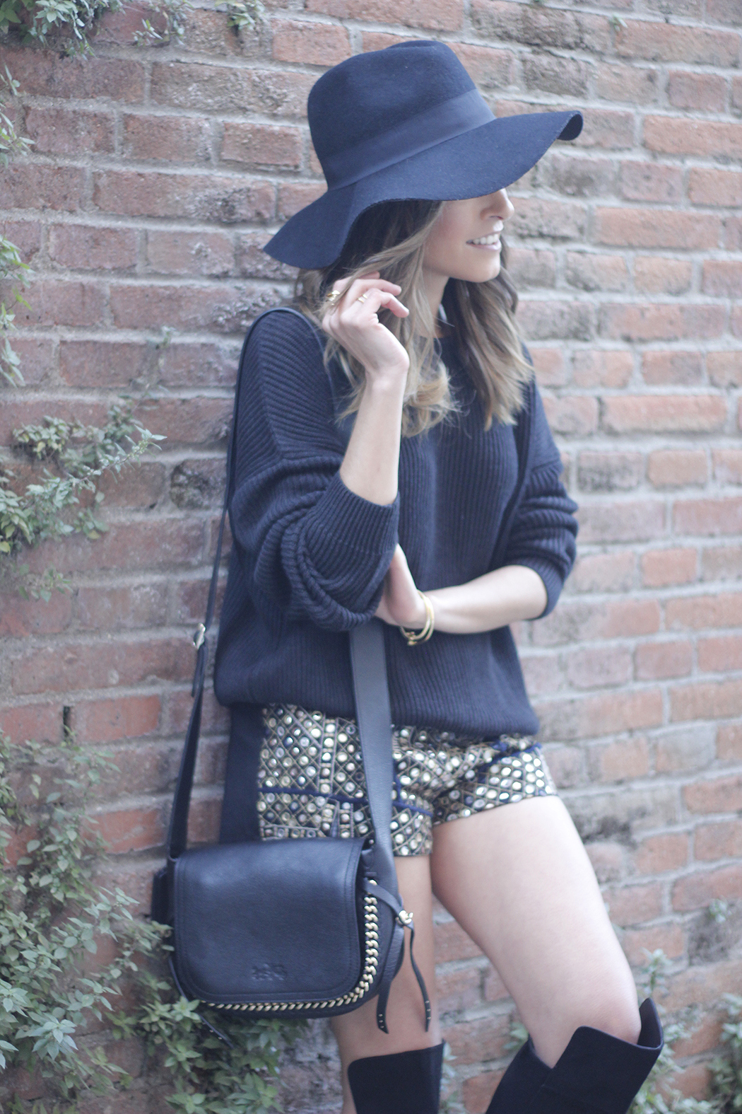 embroidered shorts black hat over the knee boots black sweater pull and bear purse coach outfit13