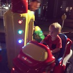 Archer and his Uncle Dallon ride a carousel! by bartlewife