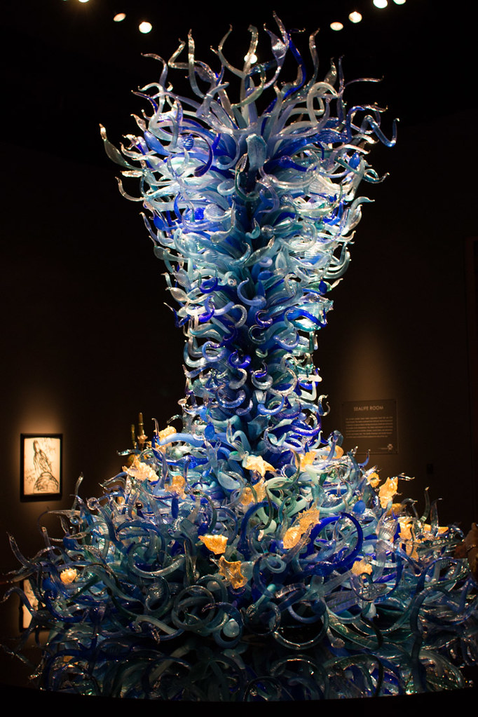 Blue and yellow glass sculpture floor to ceiling