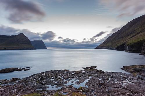 färöer sunset ocean travel landscape water rocks cliffs