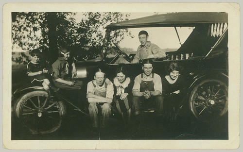 Seven young people and a car