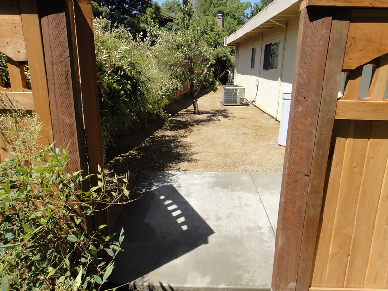 Concrete Trash Can Pad And Decomposed Granite Side Yard In
