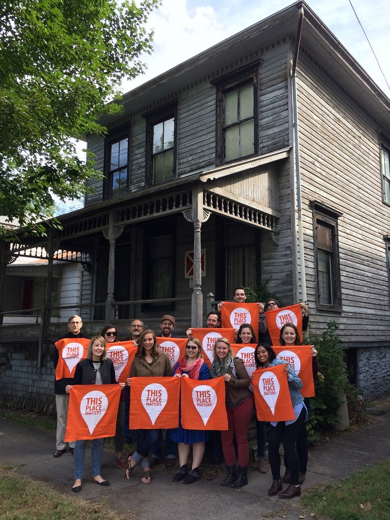 HPP students with CRP professors Michael Tomlan and Jeffrey Chusid in front of the Dennis Newton house in Ithaca, the site of the first African American fraternity in the United States.