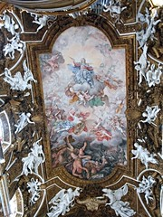 """Virgin Mary's Glory, Fall of rebellious angels"" - fresco (1675) by Giovanni Domenico Cerrini - Ceiling with stucco Angels - Santa Maria della Vittoria Church in Rome"