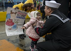A Sailor reunites with his family after the return of USS Ronald Reagan (CVN 76) to Yokosuka, Dec. 3. (U.S. Navy/MC3 Ryan N. McFarlane)