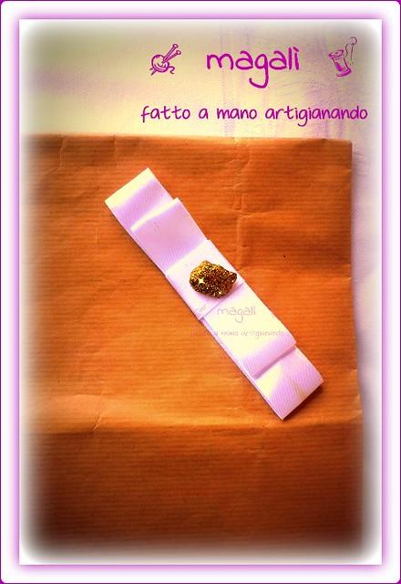fiocci e pacchetti regalo con pepite