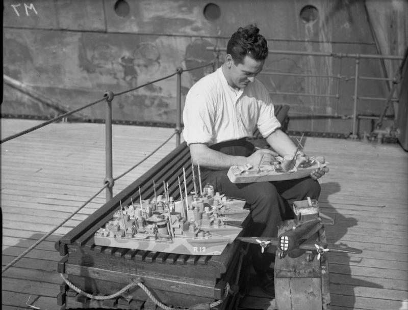 Petty Officer H Bell, of Shotts, Lanarkshire, a member of the Home Fleet, constructs model ships and aircraft to be given as presents for Christmas