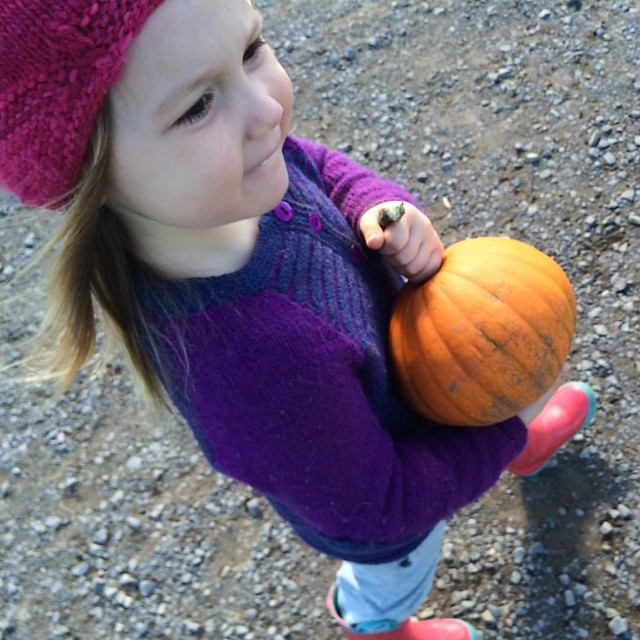 A girl and her pumpkin.