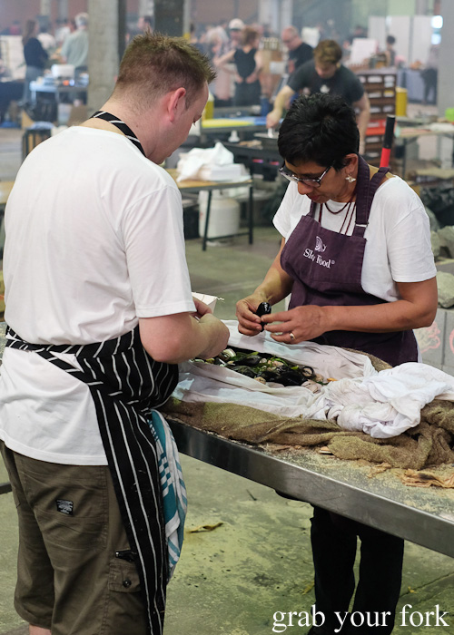 Plating the pipis and mussels after cooking in the Aboriginal earth oven at Rootstock Sydney 2015